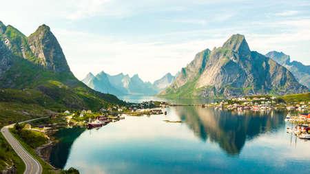 Scenic fjord landscape with Reine village, coast nature with sharp high mountain peaks, Lofoten islands North Norway. Travel destination. Foto de archivo - 128327315