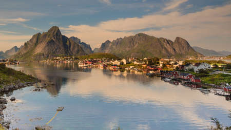 Scenic fjord landscape with Reine village, coast nature with sharp high mountain peaks, Lofoten islands North Norway. Travel destination. Stock Photo