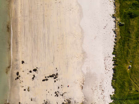 Top down view. Sea water and sand beach shore. Summertime. Stock Photo