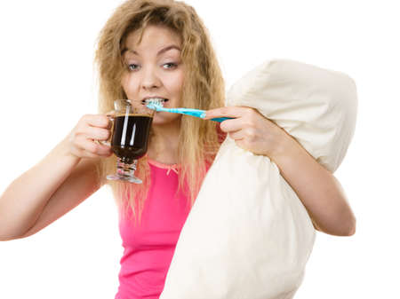 Happy woman holding toothbrush and coffee going to brush her teeth after hot drink. Stock fotó - 129300897