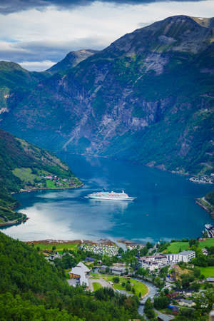 Fjord Geirangerfjord with cruise ship, view from Flydasjuvet viewing point, Norway. Travel destination