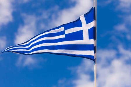 Greek flag waving outdoor on wind against blue sky. Greece Europe 스톡 콘텐츠