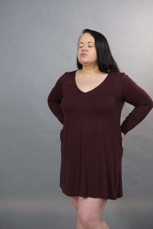 Plus size adult woman having health problem suffering with loins pain kidney ache.