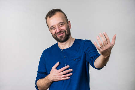 Man pretending acting be or not to be gesturing with hand. Adult guy having fun, playing theater play 版權商用圖片