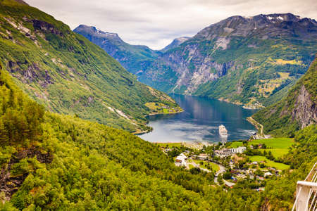 Fjord Geirangerfjord with ferry boat, view from Flydasjuvet viewing point, Norway. Travel destination