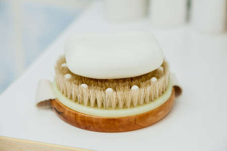 Objects for personal hygiene. Clean towel, brush and soap for cleaning. Bath, shower accessories concept.
