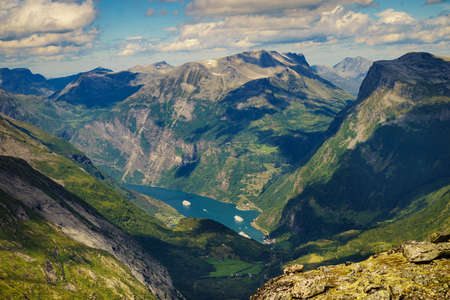 Tourism vacation and travel. Fantastic view on Geirangerfjord and mountains landscape from Dalsnibba viewpoint in Norway. Stok Fotoğraf