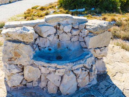 Stone water well outdoor in Mediterranean area