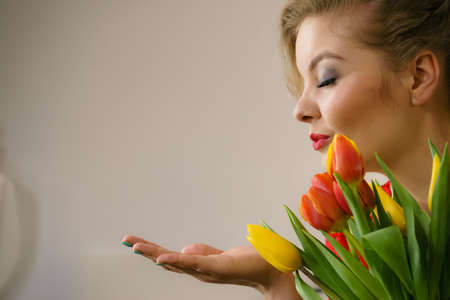 Woman holding bouquet of tulips flowers gift. Womans day, 8 march present.