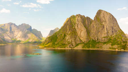 Scenic fjord landscape above the arctic circle, coast nature with sharp mountain peaks, Lofoten islands North Norway.