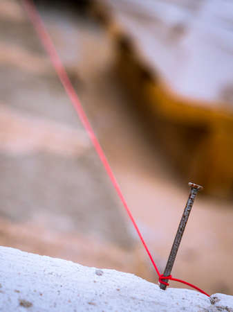 String being used as level in the construction of wall. Bricklayer Stock Photo