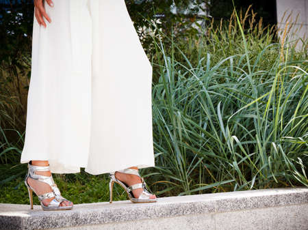 Elegant unrecognizable woman presenting fashionable urban outfit. High heels and trousers culottes. Reklamní fotografie