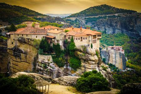 Monastery on cliff in Meteora, Thessaly Greece. Greek destinations Фото со стока