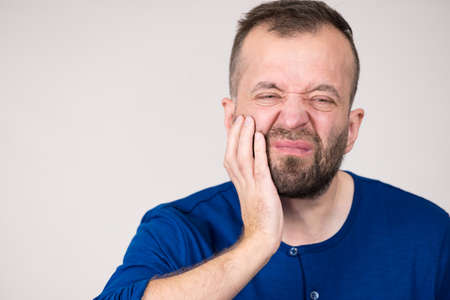Portrait of adult man suffering from tooth pain ache. Dental problem, health issues concept. Reklamní fotografie