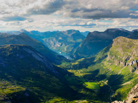 Tourism vacation and travel. Fantastic view on Geirangerfjord and mountains landscape from Dalsnibba viewpoint, evening time, Norway.