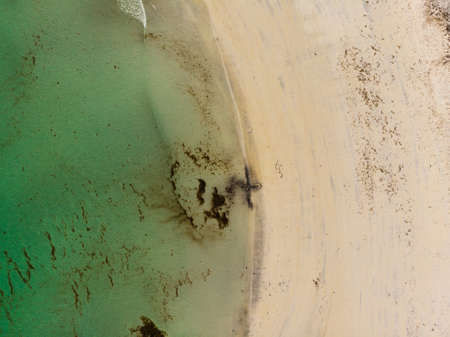 Top down view. Blue sea water surface and sand beach shore. Summertime. Zdjęcie Seryjne