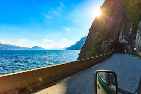 Fjord landscape and old tunnel entrance at the norwegian mountains, Norway Scandinavia. View from car