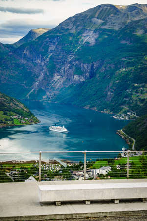 Flydalsjuvet view point, lower plateau with lookout seat. Geiranger fjord landscape. National Tourist Route in Norway
