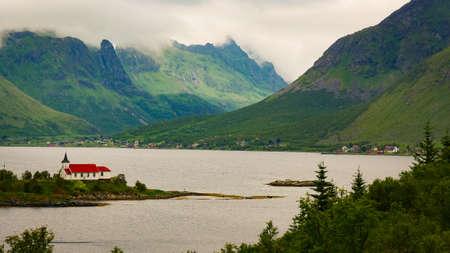 Fjord landscape with Sildpollnes Chapel, Lofoten islands, Sildpollneset peninsula on of Austvagoya, Norway. Tourist location.