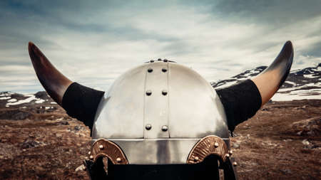 Viking helmet against mountains landscape in Norway. Tourism and traveling concept