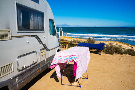 SANTA POLA, SPAIN - FEBRUARY 16, 2019: Camper on mediterranean coast of seaside spanish Santa Pola city on the Costa Blanca. Camping and airing the quilts. Stok Fotoğraf