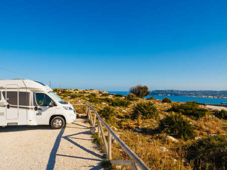 CAPE SAN ANTONIO, SPAIN - MARCH 28, 2019 : Camper car on Cape San Antonio on the north coast of Alicante province in southeastern Spain. Mediterranean seascape on Costa Blanca.