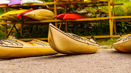 Kayaks on water shore. Rental centre. Travel, holidays and active lifestyle.
