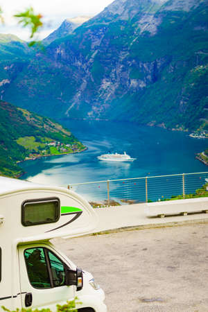 Camper car on Flydasjuvet viewpoint and fjord Geirangerfjord with cruise ship, Norway. Travel destination. 스톡 콘텐츠
