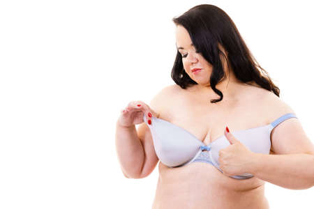 Plus size fat mature woman wearing bra lingerie giving thumb up, on white. Happy body positive female. Love yourself, no fatphobia.