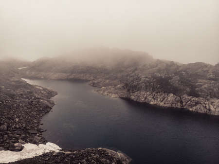 Lakes in stone rocky mountains, misty foggy day. Norway summer landscape. Norwegian national tourist scenic route Ryfylke. Фото со стока - 139896899