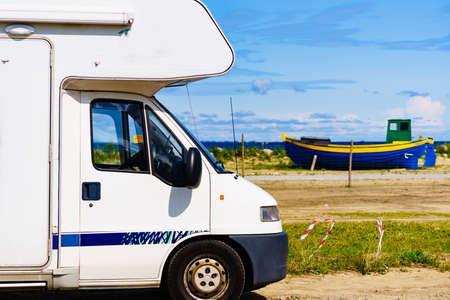Travel holidays in motorhome. Camper car on sea coast.