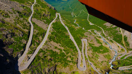 Trolls Path Trollstigen winding scenic mountain road with many cars, Norway Europe. National tourist route.
