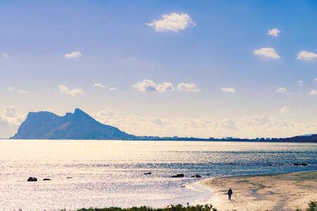 Seascape with Gibraltar rock on horizon. View from Torrecarbonera beach, Punta Mala, Andalusia Spain.