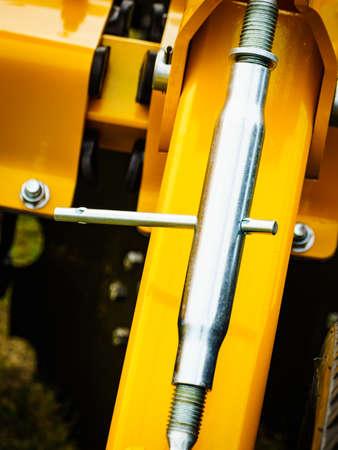 High strength steel turnbuckle, stretching screw or bottlescrew in machine. Machinery industrial detail Stock fotó