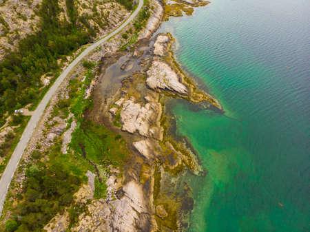 Aerial view. Norwegian landscape. Road along fjord Sagfjorden in Norway.