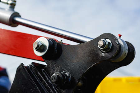 Hydraulic mechanism on modern machine. Industrial detail piston in machinery. Technology. Archivio Fotografico