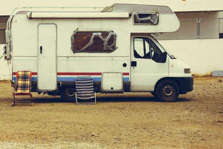 Old camper car recreation vehicle with broken windows