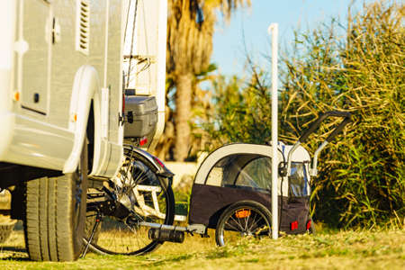 Camper rv and bicycle with trailer cart for shopping, children or dog. Holidays and travel in motorhome. Standard-Bild - 149897072