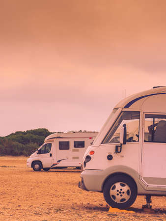 Camper leveling support hydraulic steady leg in use. Caravaning and accessories for motor home. Banco de Imagens