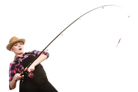 Spinning equipment, angling, cheerful fisherwoman concept. Shocked woman in sun hat holding fishing rod hunting and fighting with fish on hook Banque d'images