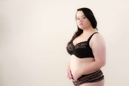 Plus size fat woman in lingerie. Overweight mature female wearing underwear.