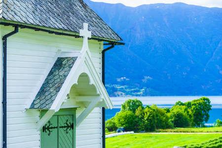 Norwegian white wooden church in Nes village at fjord Lusterfjord, Vestland county, Norway. 免版税图像