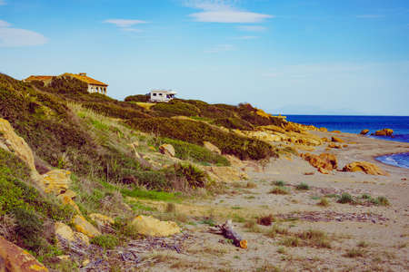 Camper on mediterranean coast, beach Torrecarbonera, Punta Mala, Alcaidesa, Spain. Vacation and adventure with mobile home. Wide shot