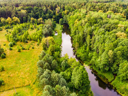 Aerial view. Green forest and river Brda, canoe trail in Tuchola national park, Poland. Green summer landscape in Europe.