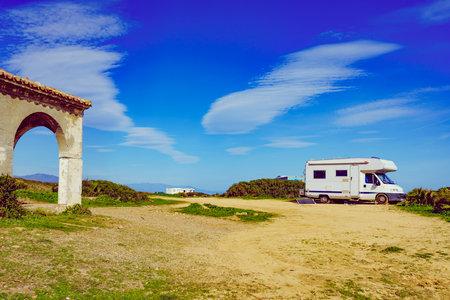 Camper on mediterranean coast, beach Torrecarbonera, Punta Mala, Alcaidesa, Spain. Vacation and traveling in mobile home.