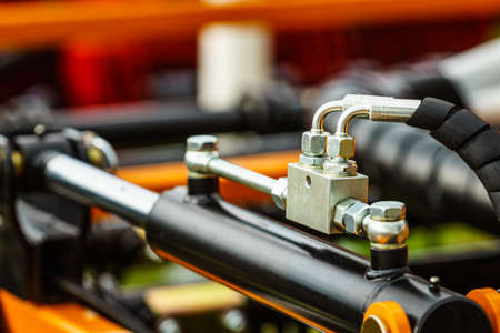 Hydraulic system on modern heavy machine. Industrial detail piston in machinery. Technology. Archivio Fotografico