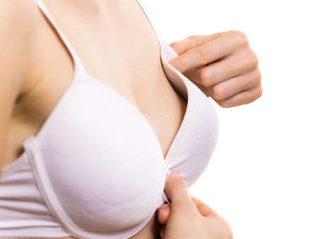 Young woman small wearing bra with big gapping cup. Female wrong size lingerie. Bosom, fitting and underwear.