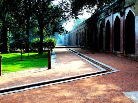 mughal: a water channel flowing through mughal char bagh gardens in delhi, india
