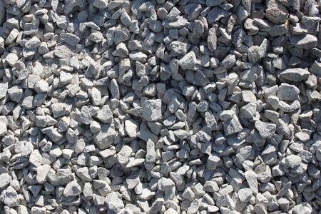 Crushed stone texture, background, gray stone Imagens