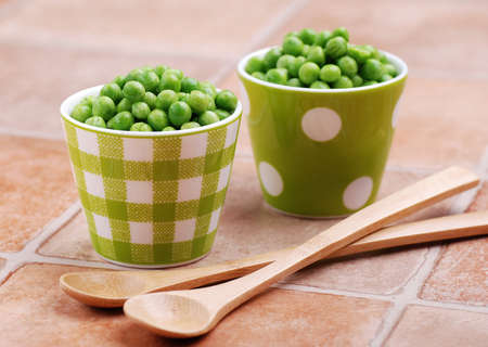 two cups with fresh peas Stock Photo - 12574880